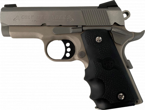 Colt Defender 9mm facing left